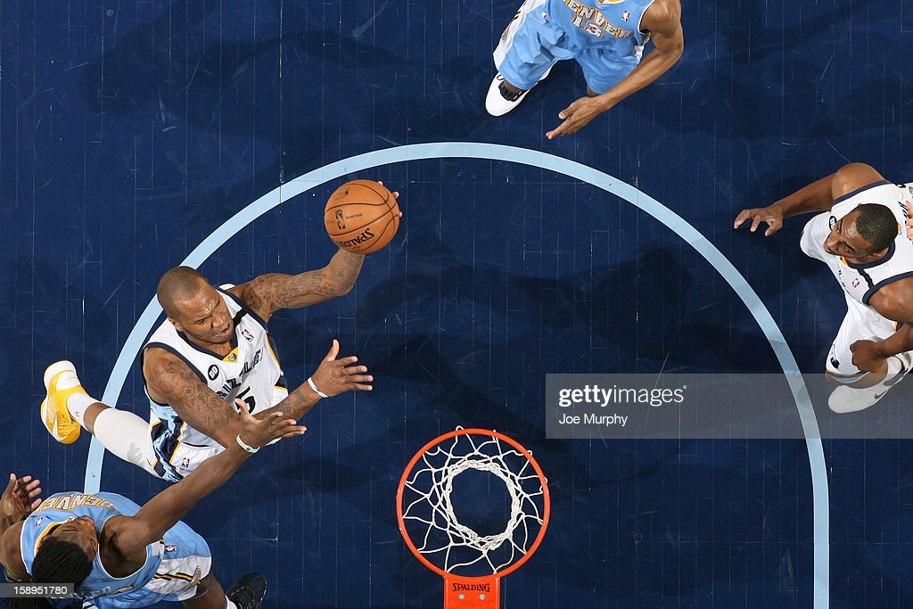 Marreese Speights #5 of the Memphis Grizzlies drives to the basket against the Denver Nuggets on December 29, 2012 at FedExForum in Memphis, Tennessee.