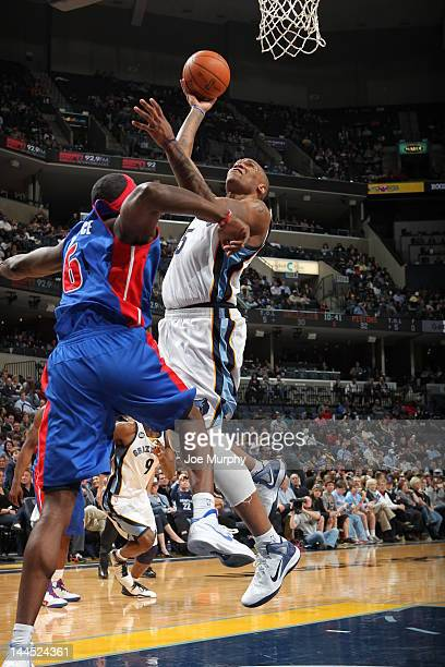 Marreese Speights of the Memphis Grizzlies goes to the basket against Ben Wallace of the Detroit Pistons during the game on March 3 2012 at...