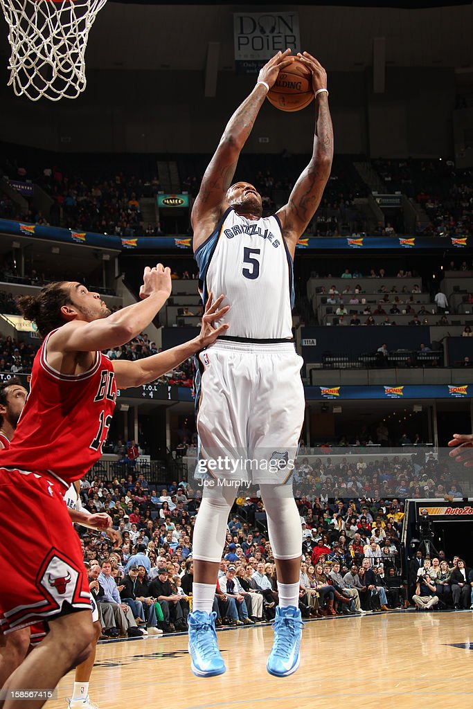 Marreese Speights #5 of the Memphis Grizzlies grabs a rebound over Joakim Noah #13 of the Chicago Bulls on December 17, 2012 at FedExForum in Memphis, Tennessee.
