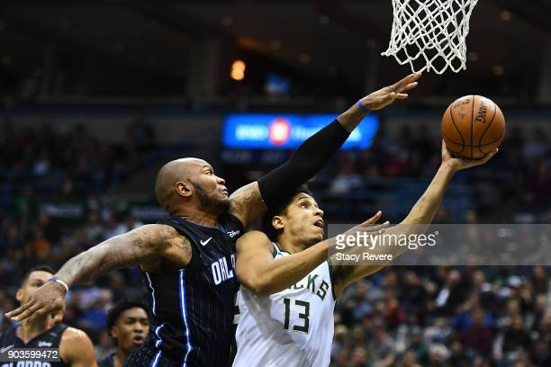 Marreese Speights of the Orlando Magic defends a shot by Malcolm Brogdon of the Milwaukee Bucks during the first half of a game at the Bradley Center...