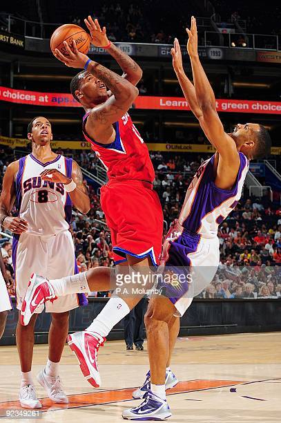Marreese Speights of the Philadelphia 76ers puts up a shot against Grant Hill of the Phoenix Suns during the preseason game on October 16 2009 at US...