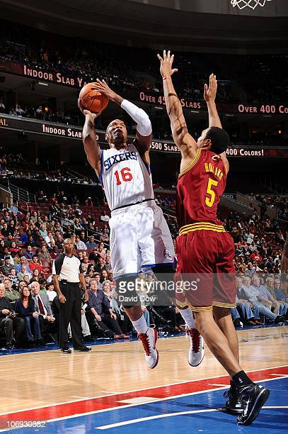 Marreese Speights of the Philadelphia 76ers shoots against Ryan Hollins of  the Cleveland Cavaliers during the 07add173e
