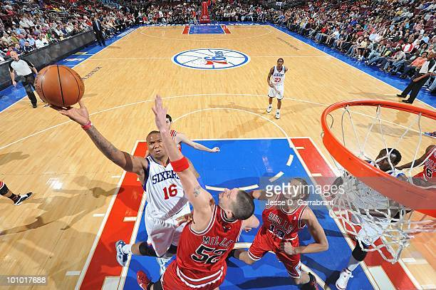 Marreese Speights of the Philadelphia 76ers takes the ball to the basket against Brad Miller of the Chicago Bulls during the game on March 20 2010 at...