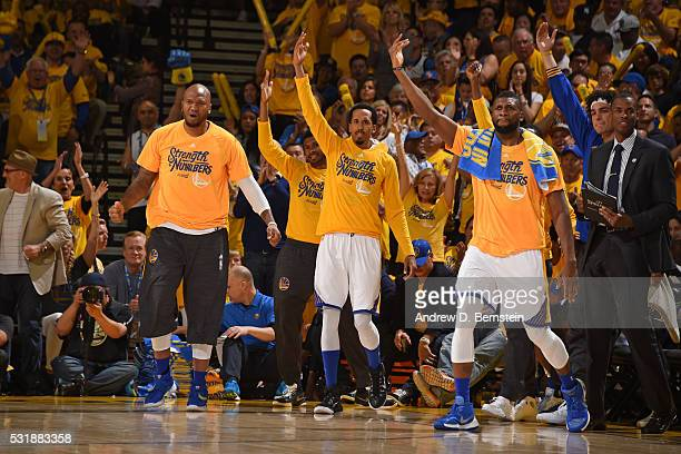 Marreese Speights Shaun Livingston and Festus Ezeli of the Golden State Warriors celebrates during the game against the Oklahoma City Thunder in Game...