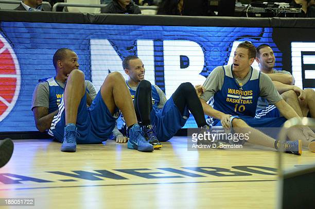 Marreese Speights Stephen Curry and David Lee of the Golden State Warriors relaxes during Fan Appreciation Day as part of the 2013 Global Games on...