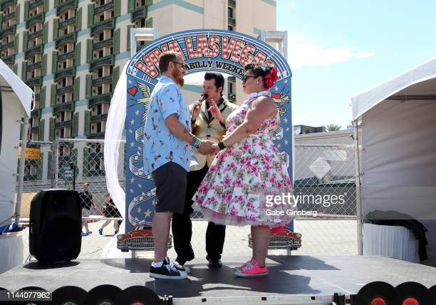 Marriage officiant Brian Mills performs a wedding vow renewal ceremony for Chad Bretz and Nikki Baim both of Pennsylvania during the Viva Las Vegas...