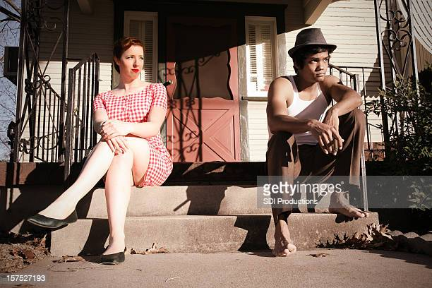 marriage problems between vintage 1940s husband and wife on porch - beautiful women smoking cigars stock photos and pictures