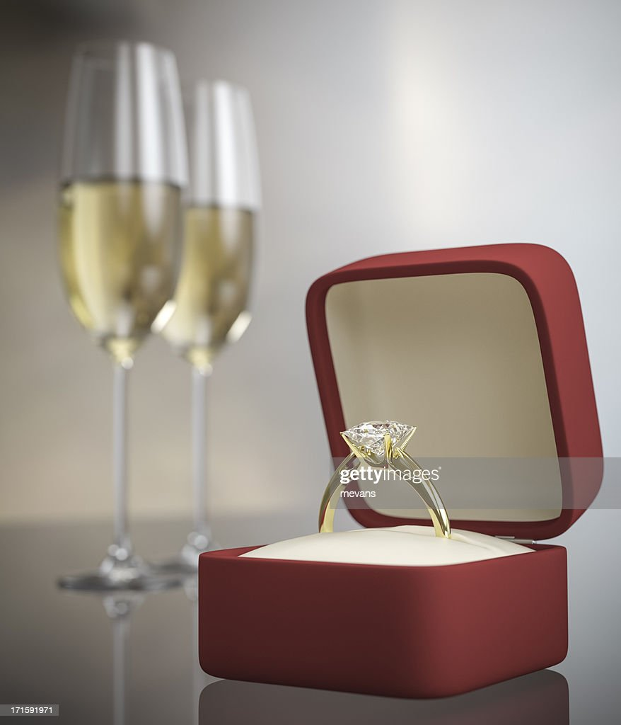 Marriage proposal concept with ring and two glasses of wine : Stock Photo