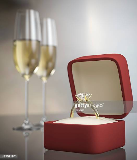 Marriage proposal concept with ring and two glasses of wine