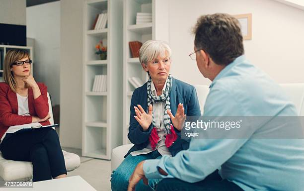 Marriage Therapy. Mature Couple Talking to Counselor