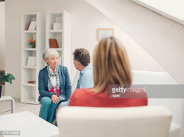 marriage therapy. mature couple talking to counselor - psychiatrist's couch stock pictures, royalty-free photos & images