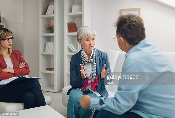 Marriage Therapy: Senior Couple Talking to Counselor