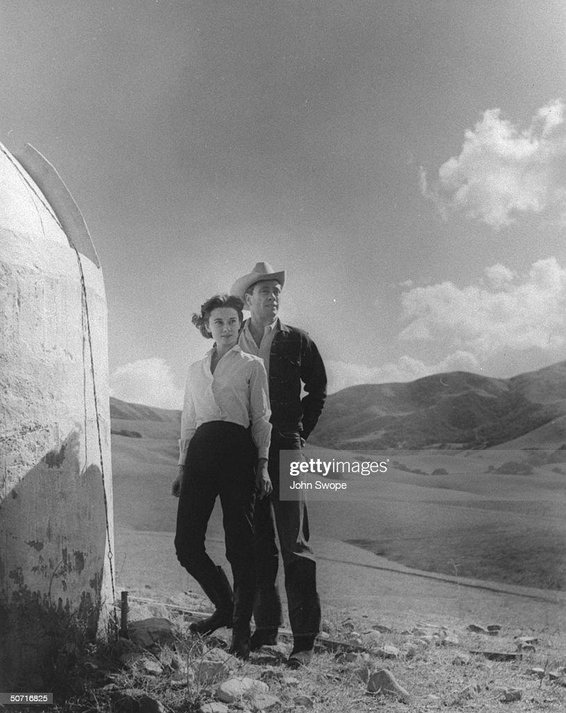 Married actors Audrey Hepburn and Mel Ferrer looking over ranch land.