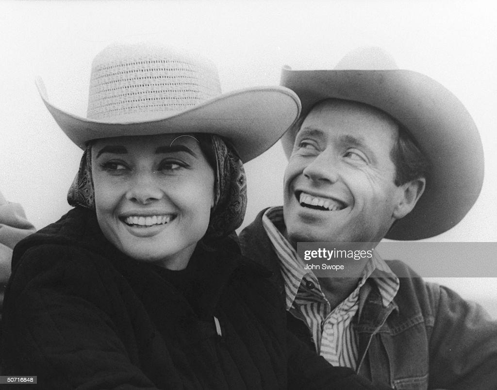 Married actors Audrey Hepburn and Mel Ferrer wearing cowboy hats.