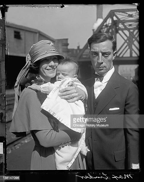 Married actors Buster Keaton and Natalie Talmadge standing on a train platform with their baby Joseph Chicago Illinois 1922