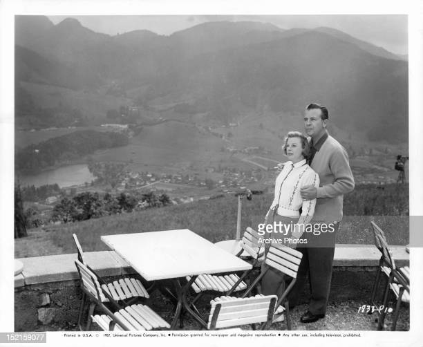 Married actors Dick Powell and June Allyson on a terrace in the mountains circa 1945