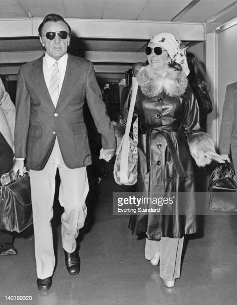Married actors Elizabeth Taylor and Richard Burton arrive at Heathrow Airport in London en route from South Africa 10th November 1975 A month earlier...