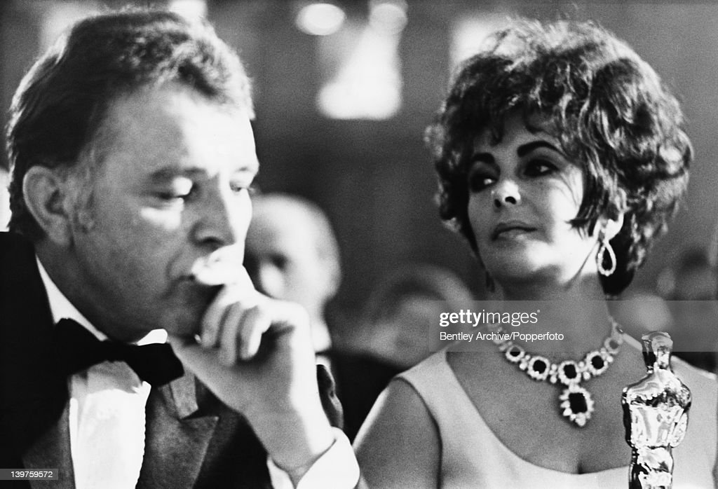 Married actors Elizabeth Taylor (1932 - 2011) and Richard Burton (1925 - 1984) attend the BAFTA Awards dinner at Grosvenor House in London, 26th April 1967. They won the Best British Actress and Best British Actor awards for their roles in 'Who's Afraid of Virginia Woolf?' and Taylor was also presented with an Academy Award (pictured) for the same part. Taylor is wearing her Bulgari diamond and emerald necklace.