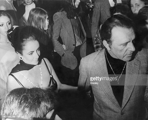 Married actors Elizabeth Taylor and Richard Burton during his 50th birthday party at the Dorchester Hotel London 10th November 1975
