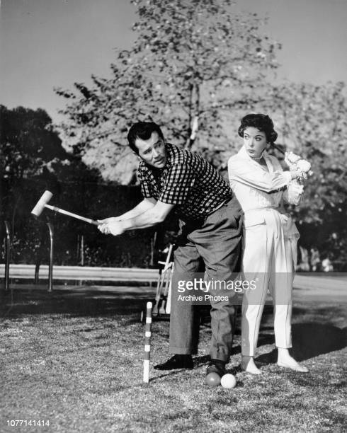 Married actors Ida Lupino and Howard Duff playing croquet circa 1955