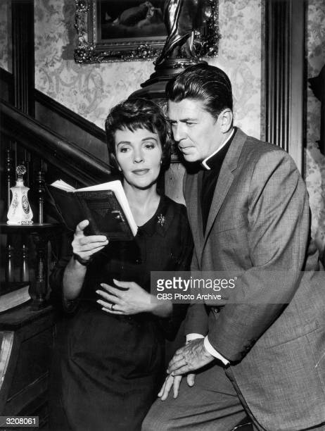 Married actors Nancy Davis and Ronald Reagan playing a clergyman read from a diary in the 'Money and the Minister' episode of the television drama...