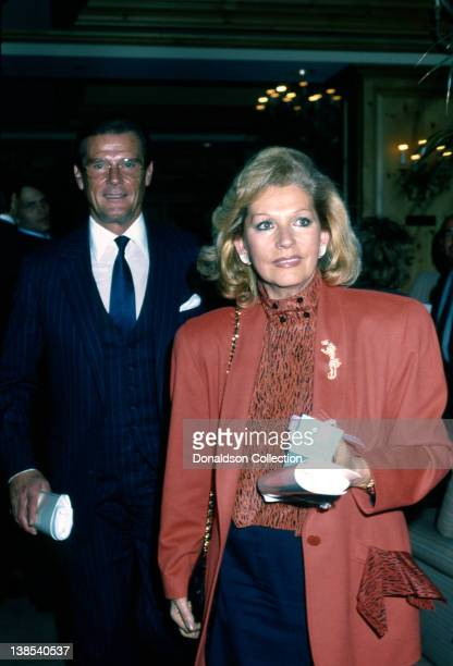 Married actors Roger Moore and his wife Luisa Mattioli attend an event in February 1988 in Los Angeles California