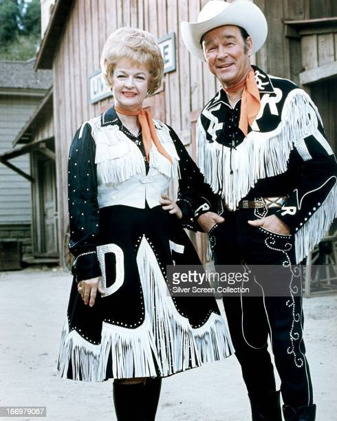 Married American actors Dale Evans and Roy Rogers in western outfits circa 1965