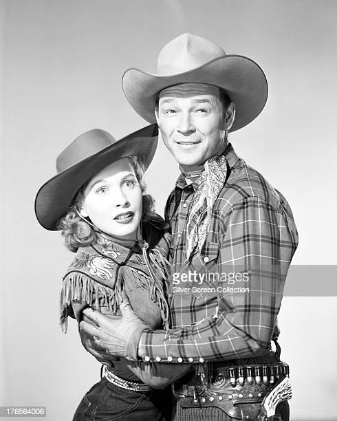 Married American actors Dale Evans and Roy Rogers in western outfits circa 1950
