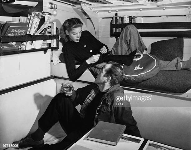 Married American actors Humphrey Bogart and Lauren Bacall on board a yacht, circa 1955.