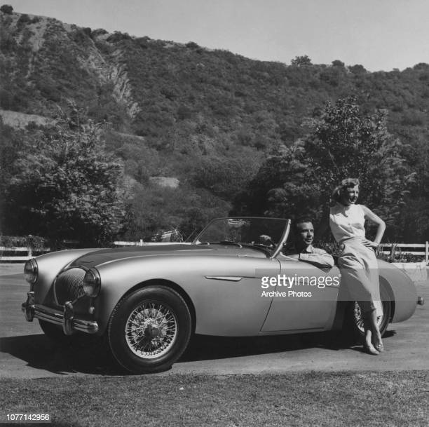 Married American actors June Allyson and Dick Powell out for a drive in their AustinHealey 100 May 1955