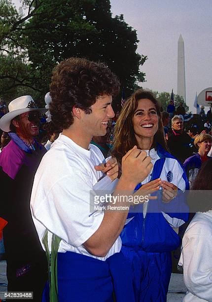 Married American actors Kirk Cameron and Chelsea Noble share a laugh during the Great American Workout event on the South Lawn of the White House...