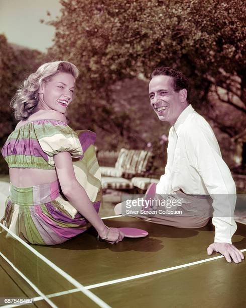 Married American actors Lauren Bacall and Humphrey Bogart playing table tennis circa 1950
