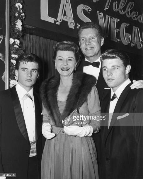 Married American actors Ozzie and Harriet Nelson smile with their sons Rick and David as they attend the premiere of director Mark Robson's film...