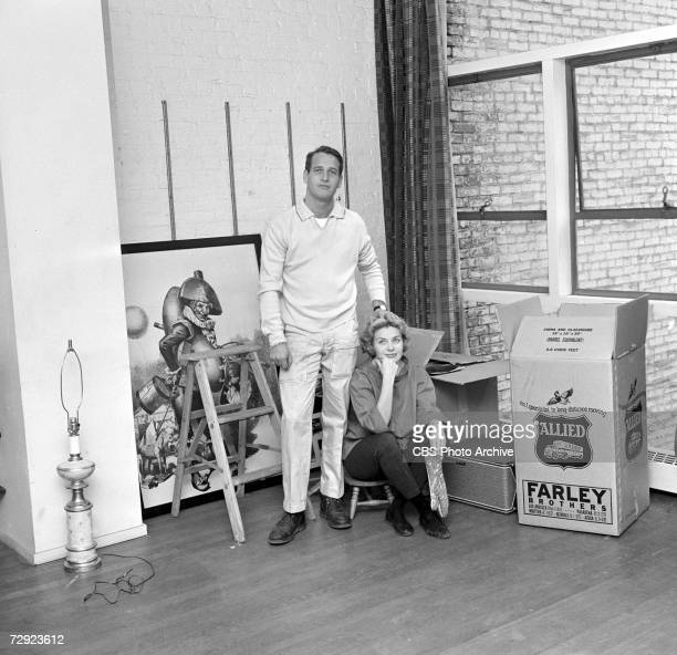 Married American actors Paul Newman and Joanne Woodward pose next to several moving boxes in ther 11th Street home on an episode of the CBS celebrity...