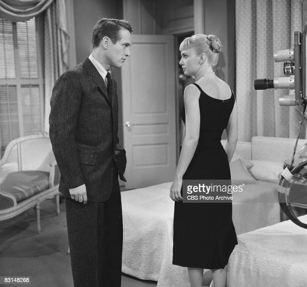 Married American actors Paul Newman and Joanne Woodward stand near a television camera during a television production based on Irwin Shaw's story...