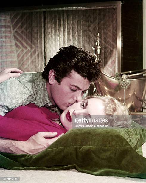 Married American actors Tony Curtis and Janet Leigh , circa 1955.