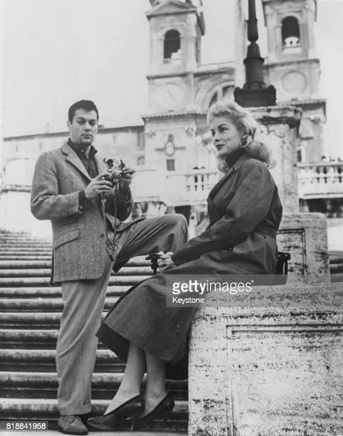Married American actors Tony Curtis and Janet Leigh on the steps of Trinita dei Monti in Rome, where they are on vacation, 9th December 1955.