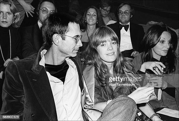 Married American actors Tony Perkins and Berry Berenson attend the premiere of the film 'Pumping Iron', New York, New York, January 17, 1977....