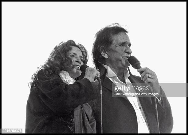 Married American Country singers June Carter Cash and Johnny Cash perform onstage during a Billy Graham rally in Central Park, New York, New York,...