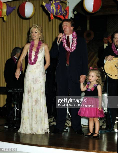 Married American couple actress Marla Maples and real estate developer Donald Trump with their daughter Tiffany stand on stage at the MaraLago estate...