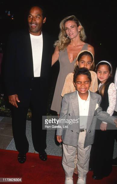 Married American couple OJ Simpson and Nicole Brown Simpson , along with their children Justin Sydney, and Jason, attend a screening of 'Naked Gun 33...