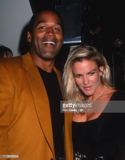 Married American couple OJ Simpson and Nicole Brown Simpson attend the grand opening of the HarleyDavidson Cafe New York New York September 26 1989