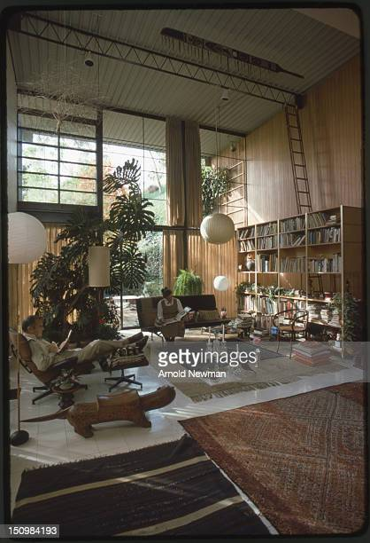 Married American designers Charles and Ray Eames read in the living room of their home and studio Venice California November 16 1974 This photo was...