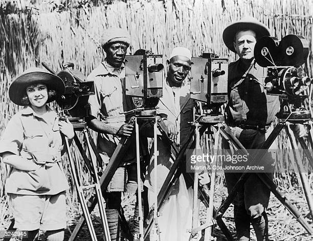 Married American explorers documentary filmmakers and safari photographers Osa and Martin Johnson pose with two unidentified photographers and their...
