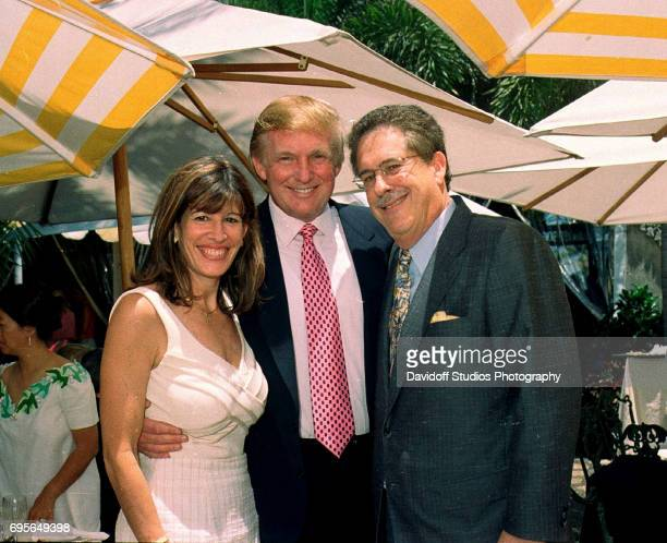 Married American insurance executives Robin Bernstein and Richard Bernstein pose on either side of real estate developer Donald Trump during a...