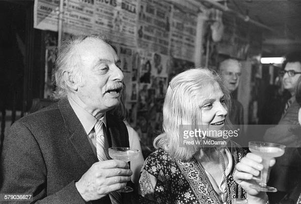 Married American poets Pulitzer Prizewinner Stanley Kunitz and Elise Asher hold champagne glasses as they attent a wrestling match New York New York...