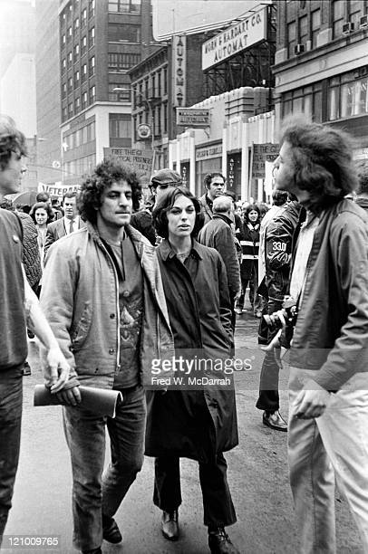 Married American political and social activists Abbie Hoffman and Anita Kushner march along Sixth Avenue with unidentified others during an...