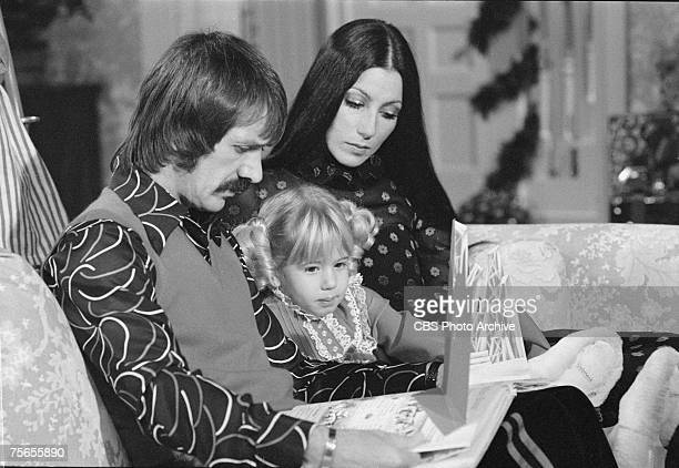 Married American singing and acting duo Sonny Bono and Cher read a book to their daughter Chastity Bono on an episode of the television variety show...