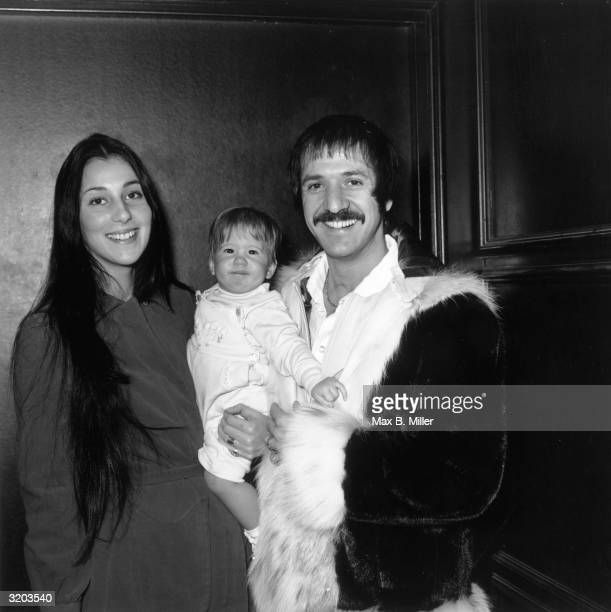 Married American singing duo Sonny and Cher smiling and holding their infant daughter Chastity at Zsa Zsa Gabor's opening at 'The Flamingo' Las Vegas...