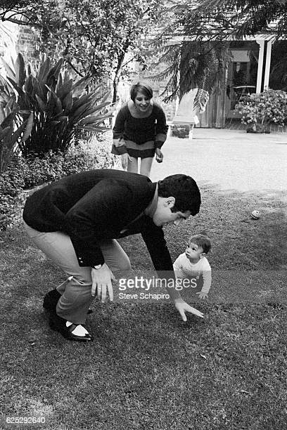 Married Americans actor Elliott Gould and actress musician Barbra Streisand play with their son Jason in the garden of their home Beverly Hills...